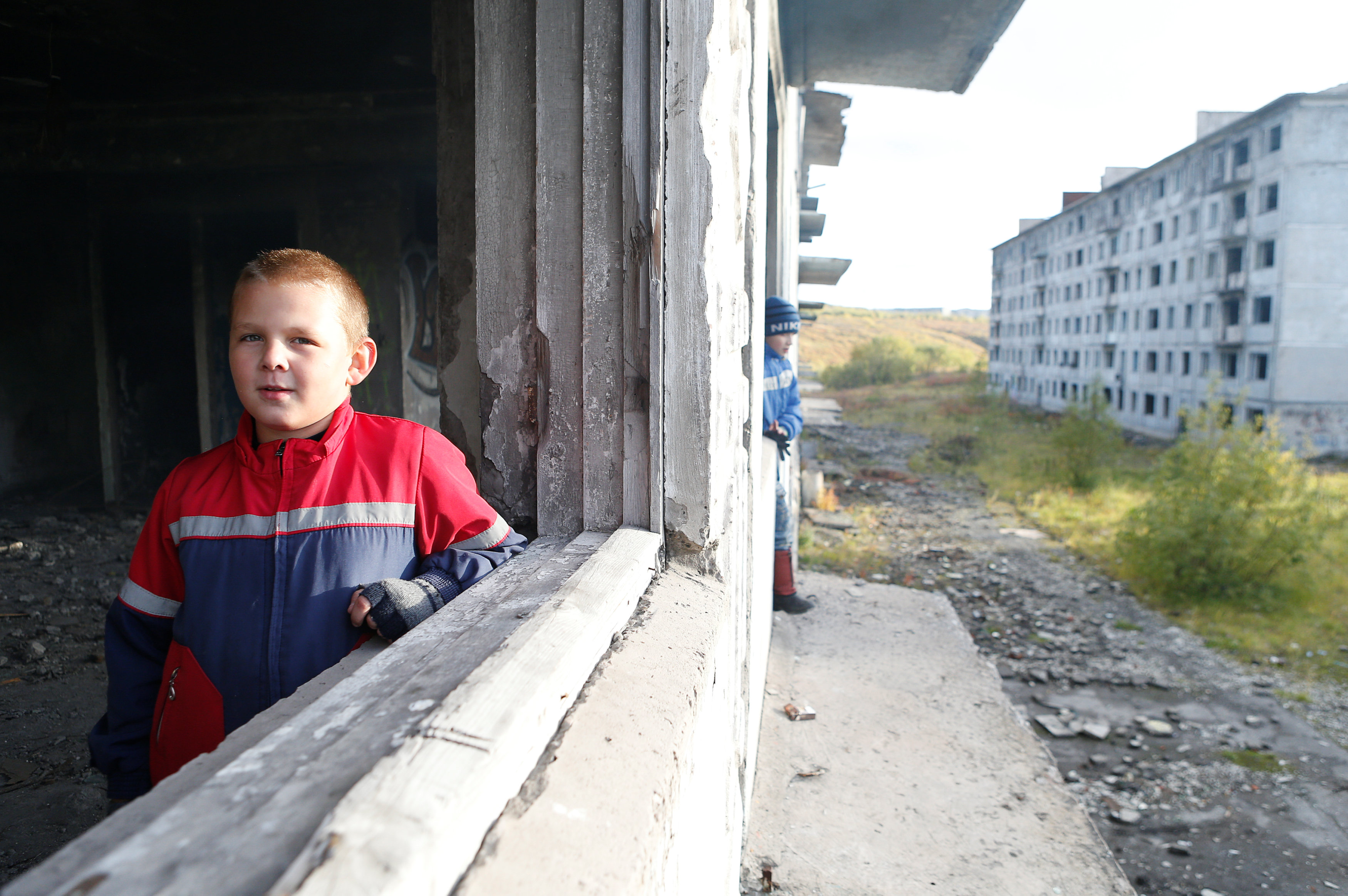 Children play inside an abandoned building in Rudnik settlement near the far northern city of Vorkuta