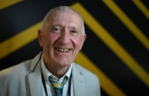 Michael Kelly poses for a photograph as the world's largest collection of diecast model aircraft, owned by him, goes on display at Shannon airport in Shannon