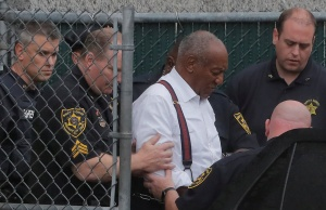 Actor and comedian Bill Cosby leaves the Montgomery County Courthouse in handcuffs after sentencing in his sexual assault trial in Norristown