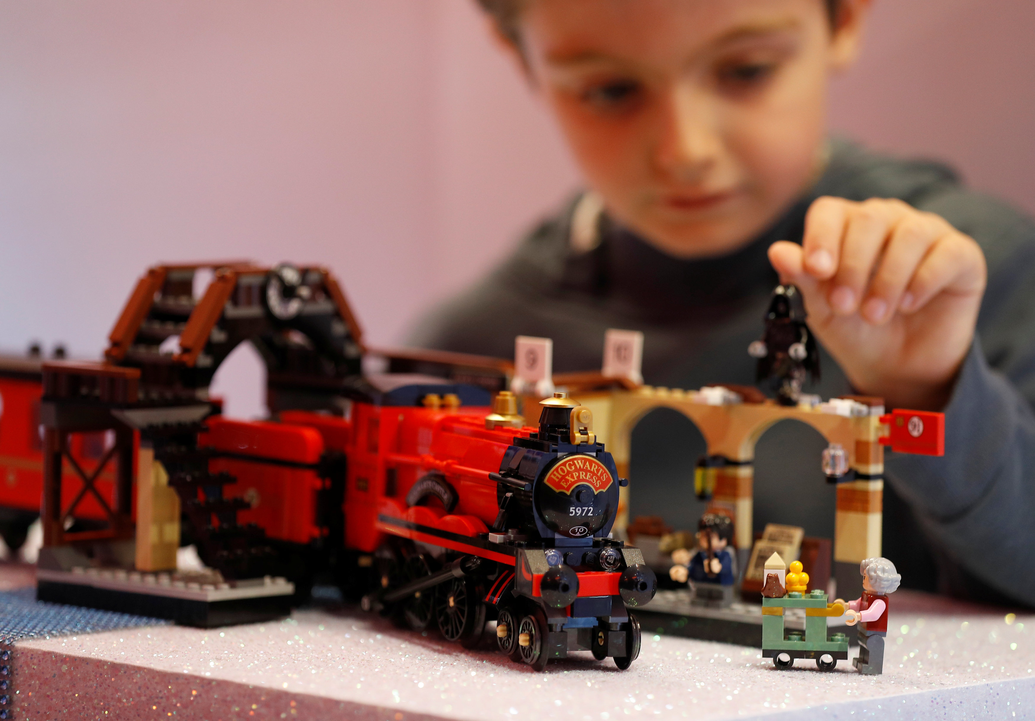 Ted Wadsworth-Hill, aged 8, plays with a Lego Harry Potter Hogwarts Express train, at the launch of Hamleys top Christmas toys in London