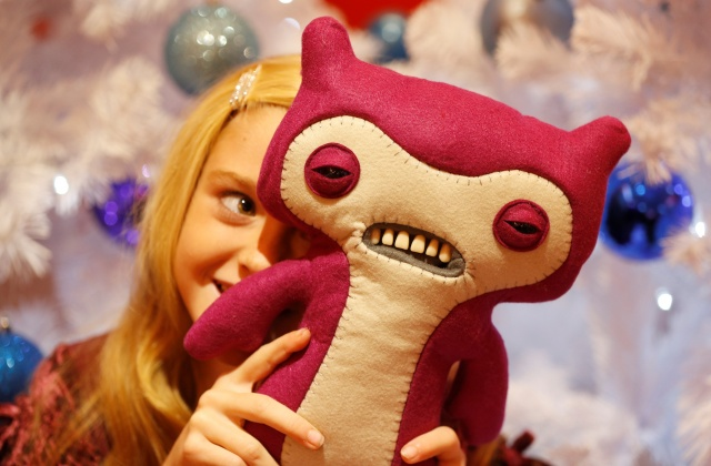 Gracie Giles, aged 8, plays with a Fuggler at the launch of Hamleys top Christmas toys in London