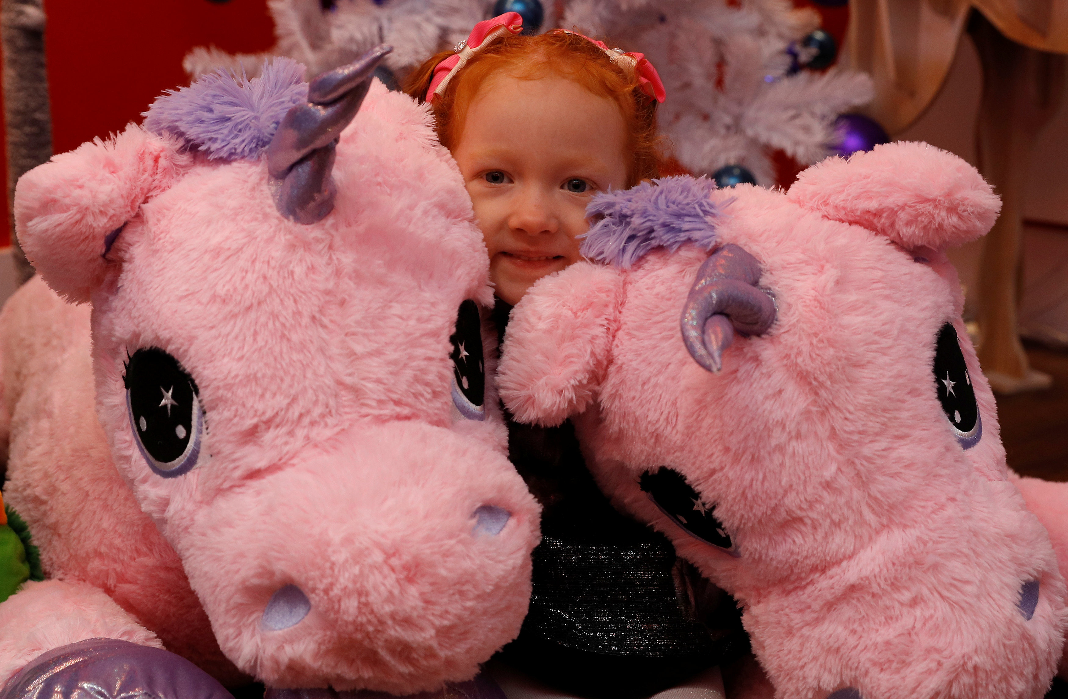 Aston Robertson-Jeyes, 3, plays with Unice Unicorn, at the launch of Hamleys top Christmas toys launch in London
