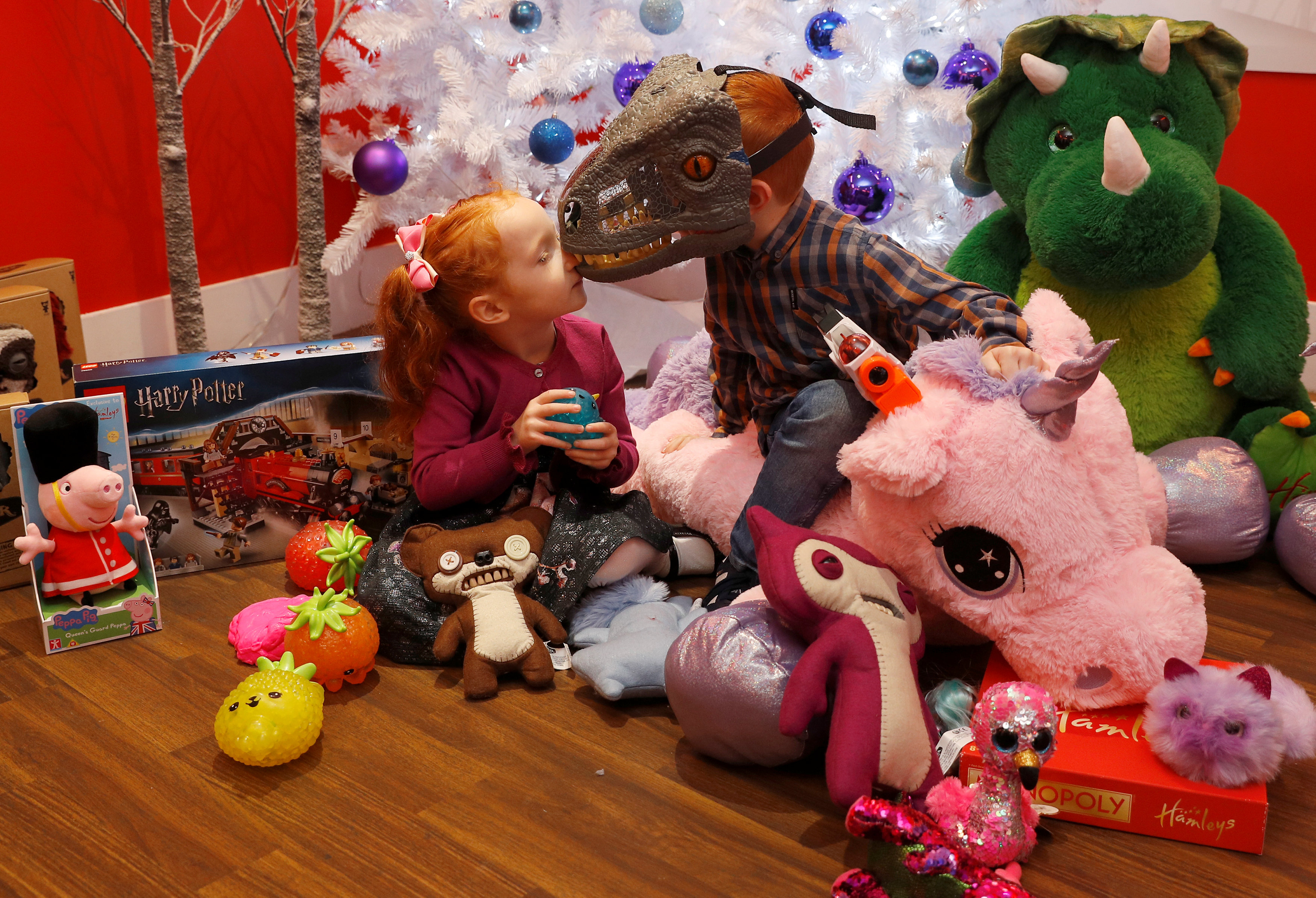 Aston Robertson-Jeyes, aged 3 and her brother Tristan, aged 7, play with some of Hamleys top toys for Christmas at a launch at their store in London