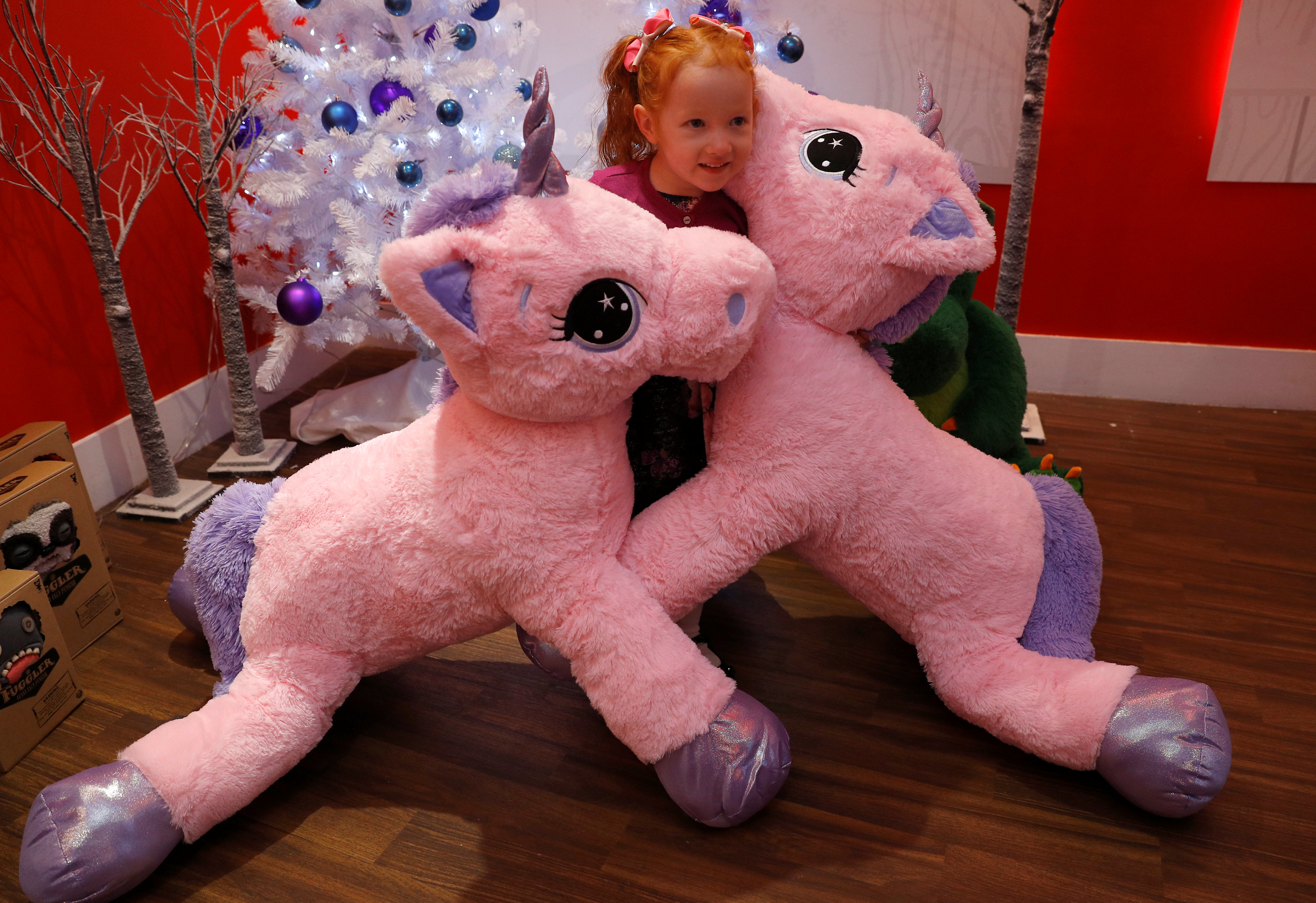 Aston Robertson-Jeyes, aged 3, plays with Unice Unicorn, at the launch of Hamleys top Christmas toys launch in London