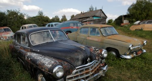 Retro cars owned by retired mechanic Krasinets are displayed at an open-air museum of Soviet-era vehicles in the village of Chernousovo