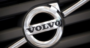 Logo of Volvo on the front grill of a Volvo truck in a customer showroom at the company's headquarters in Gothenburg