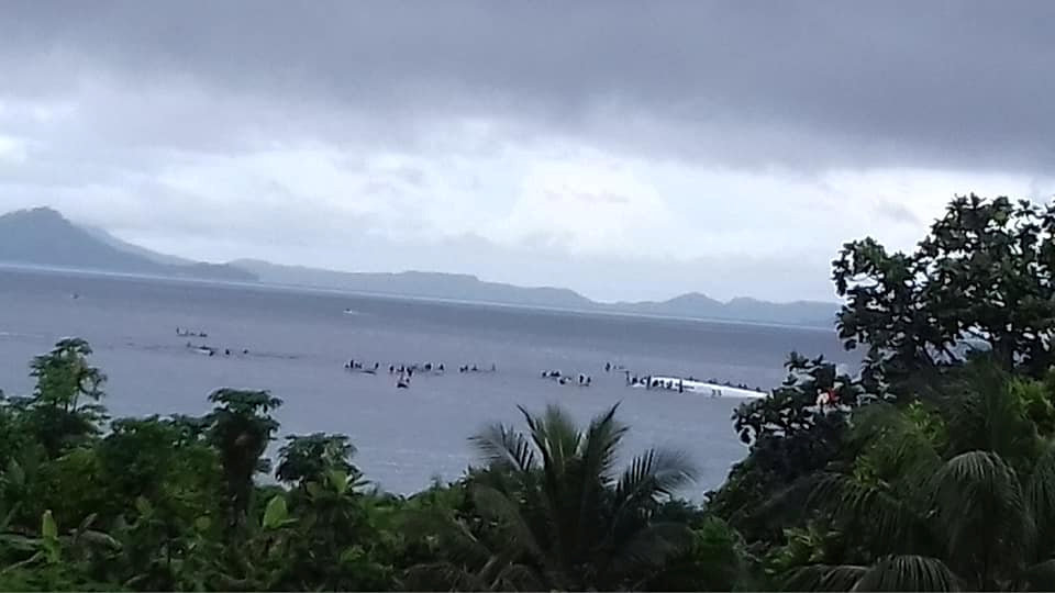 People are evacuated from an Air Niugini plane which crashed in the waters in Weno, Chuuk, Micronesia
