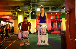 Gym members jump in sacks containing an image of Britain's Prime Minister Theresa May during a Brexfit gym class at Gym Box in London