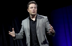 Tesla Motors CEO Elon Musk reveals the Tesla Energy Powerwall Home Battery during an event in Hawthorne California