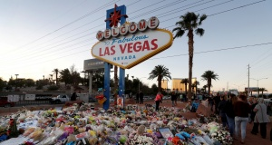 """The """"Welcome to Las Vegas"""" sign is surrounded by flowers and items, left after the October 1 mass shooting, in Las Vegas"""