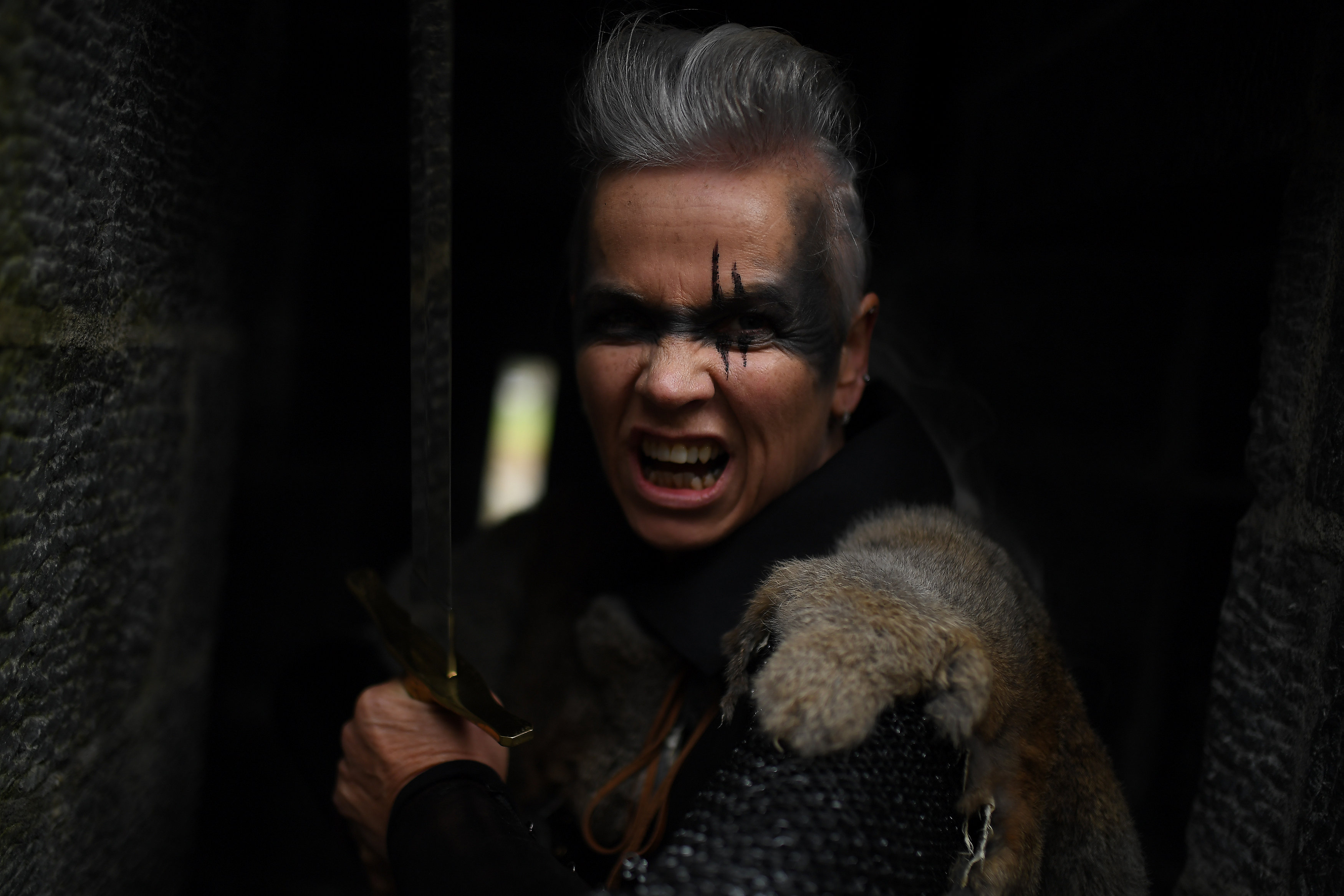 Donna Dornan posing for a photograph in costume as a Celtic warrior patrols the roof of Claregalway Castle during a medieval combat festival in Galway
