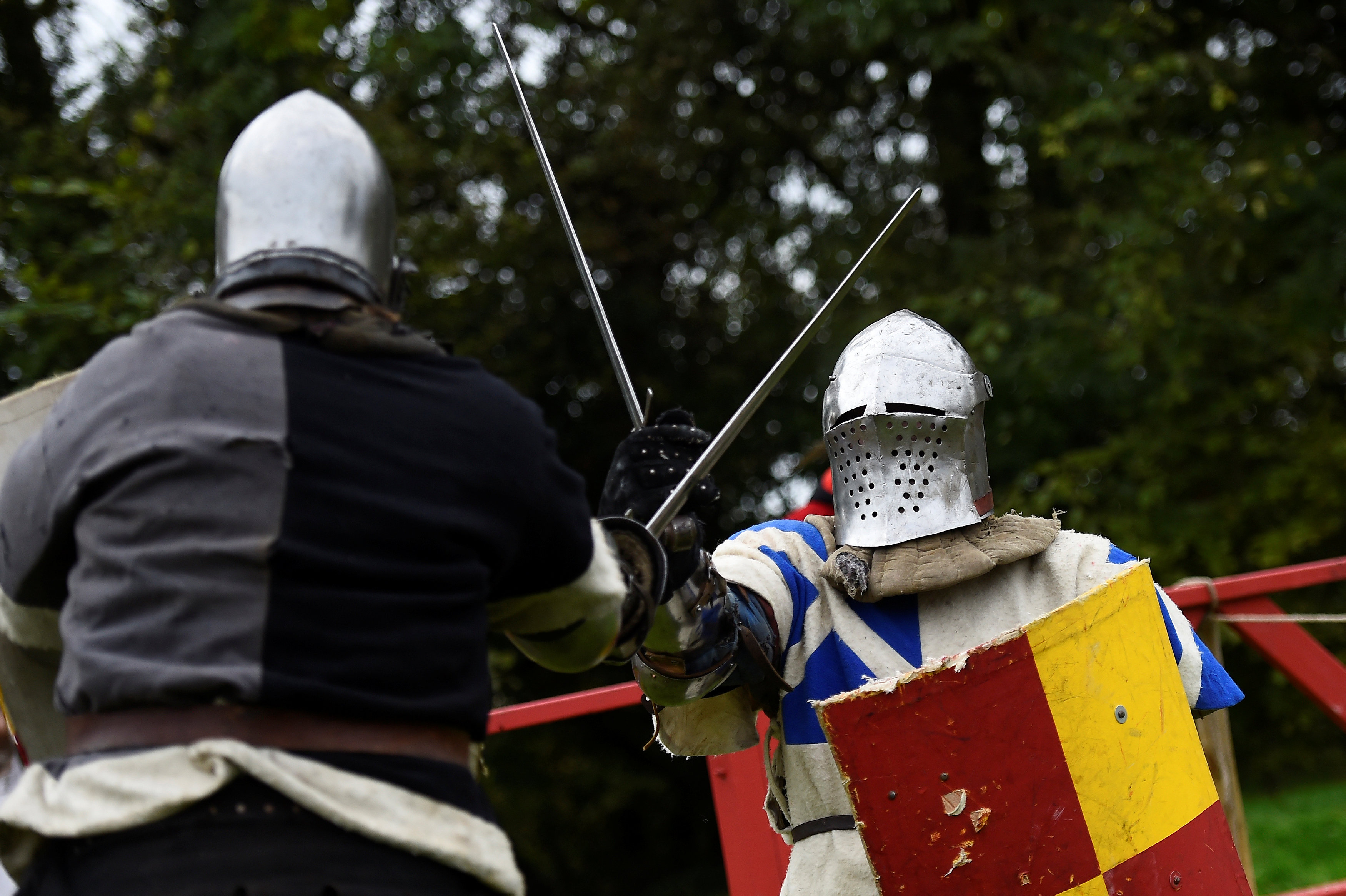 Knights duel with swords during a medieval combat festival at Claregalway castle in Galway