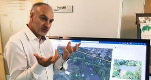 Alexandre Parilusyan of Dassault Systemes showcases Virtual Singapore, a detailed 3D model of the city-state that will be fed with big data and could assist in everything from urban planning to disaster mitigation, in Singapore