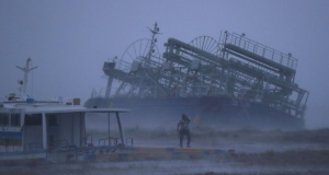 Ship washed ashore caused by Typhoon Trami is seen at a port in Yonabaru, on the southern island of Okinawa