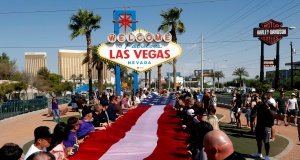 First responders and others fold an American flag following a prayer service during the one-year anniversary of the October 1 mass shooting, in Las Vegas