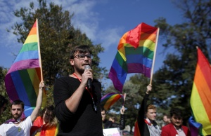 Vlad Viski of LGBT rights group Mozaiq delivers a speech during a protest in Bucharest