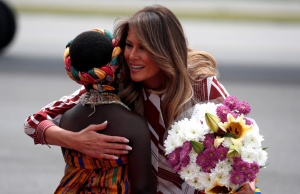U.S. first lady Melania Trump is greeted by a child on arrival in Accra, Ghana, as she begins her tour of several African countries