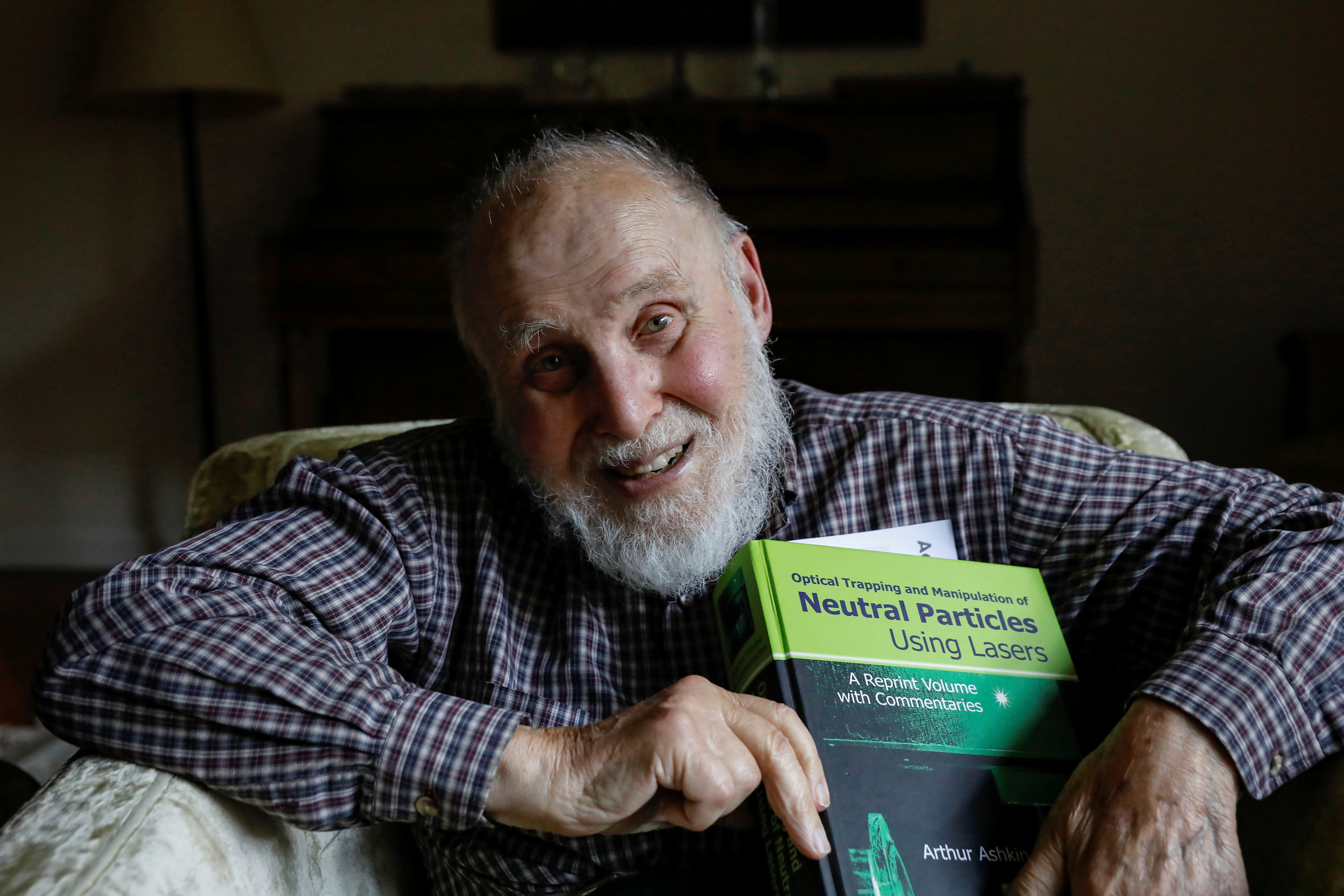 "Arthur Ashkin, who won the 2018 Nobel Prize for Physics for inventing ""optical tweezers"" poses in his home in New Jersey"