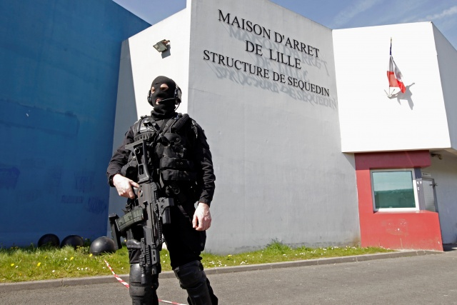 A special police officer stands guard in front the jail of Sequedin near Lille