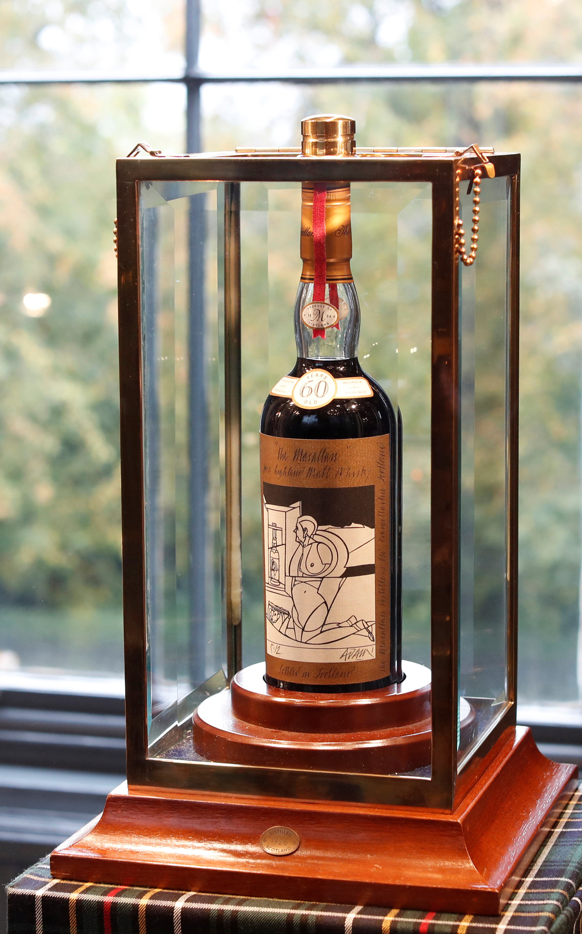 A 60-year old The Macallan Valerio Adami 1926 is seen in a glass case after it was auctioned for a record amount at Bonhams in Edinburgh, Scotland