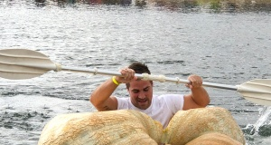 A man paddles his giant pumpkin boat during the raditional pumpkin race in Lohmar