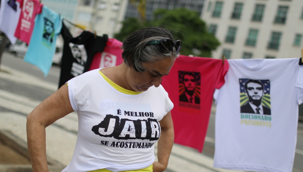 A supporter of presidential candidate Jair Bolsonaro, wears a T-shirt which reads: