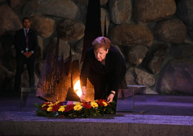 German Chancellor Angela Merkel lays a wreath during a ceremony at Yad Vashem World Holocaust Remembrance Center in Jerusalem