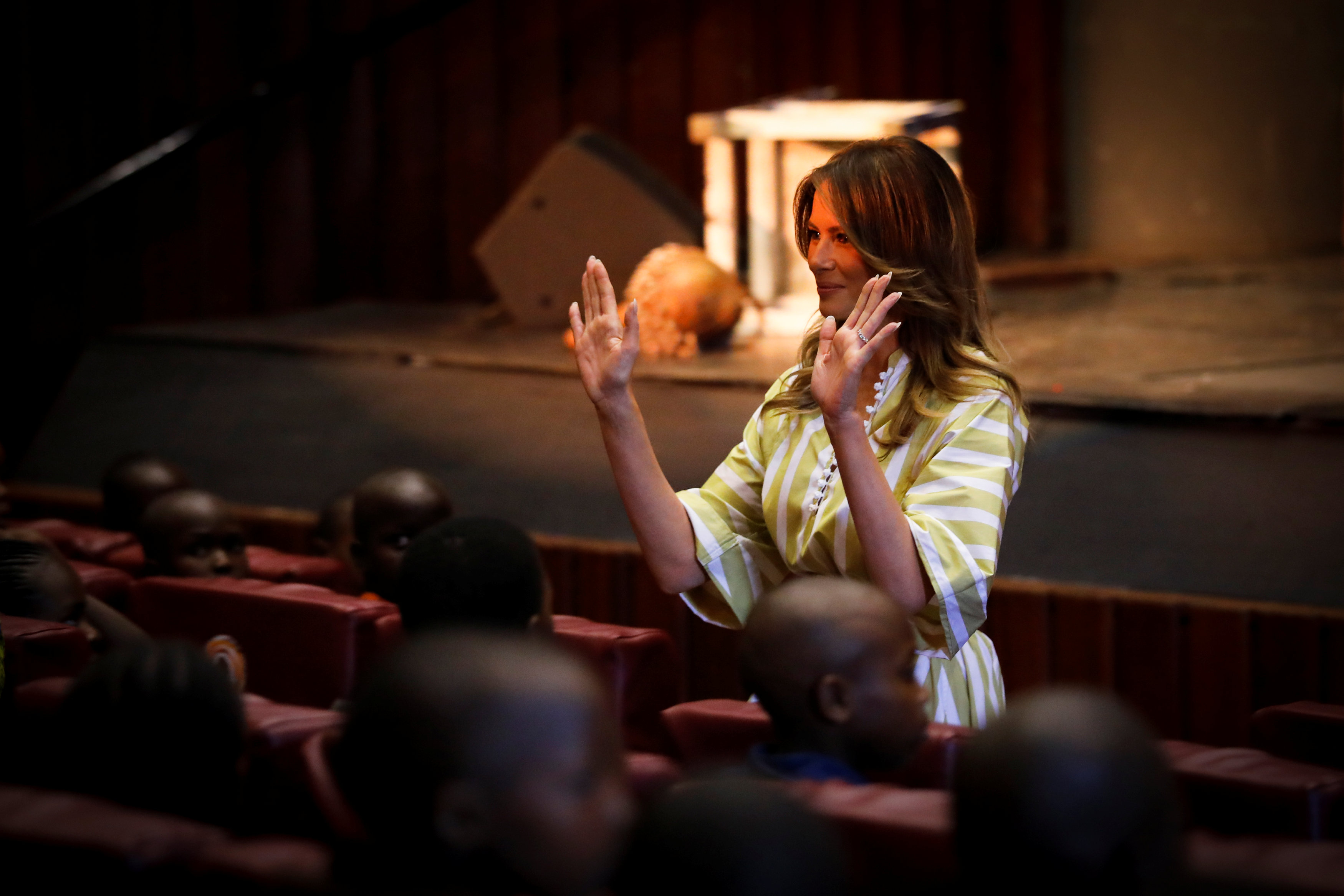 U.S. first lady Melania Trump greets children after attending a performance inside the auditorium at the Kenya National Theatre in Nairobi