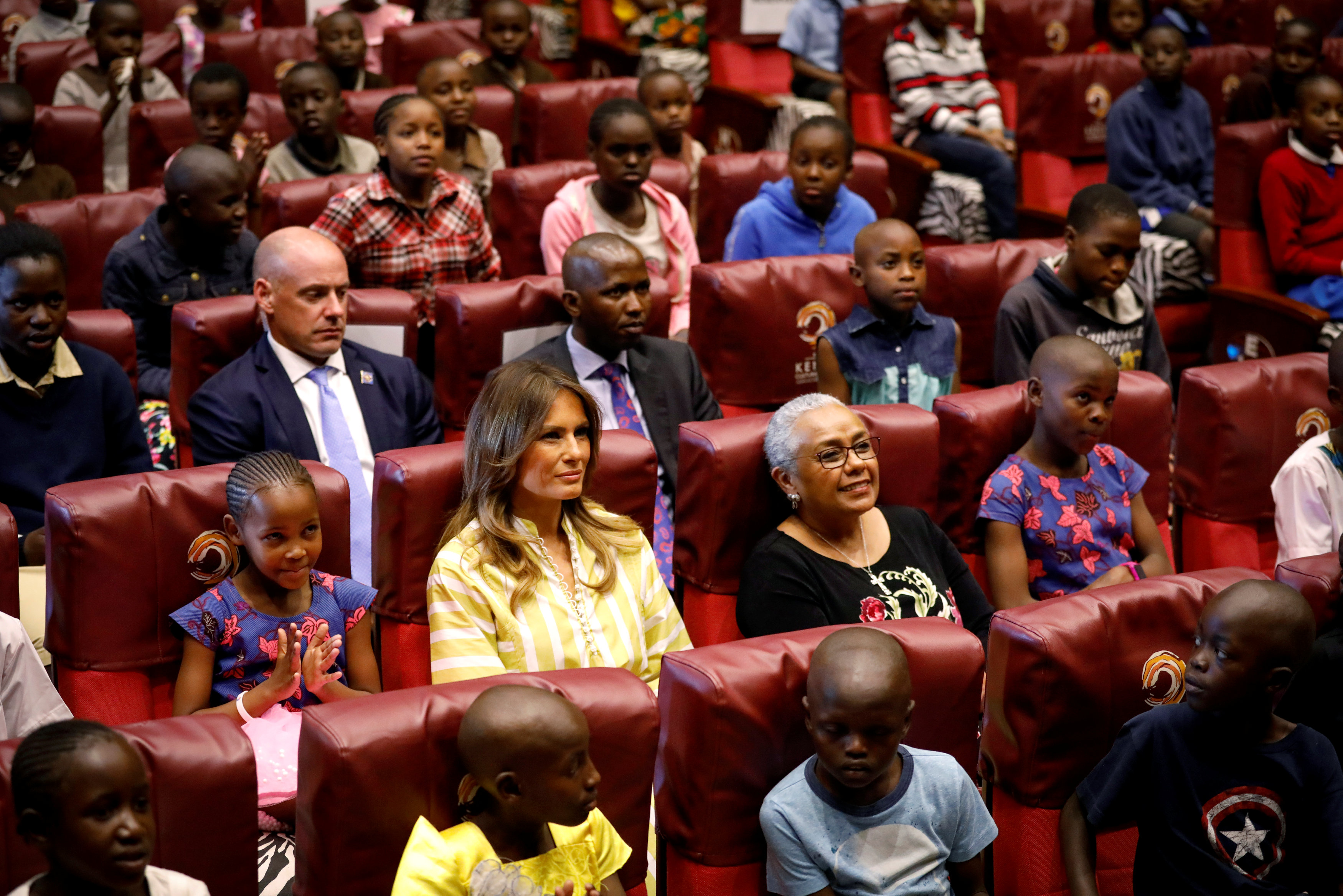 U.S. first lady Melania Trump and Kenya's first lady Margaret Kenyatta sit inside the auditorium ahead of a play at the Kenya National Theatre in Nairobi