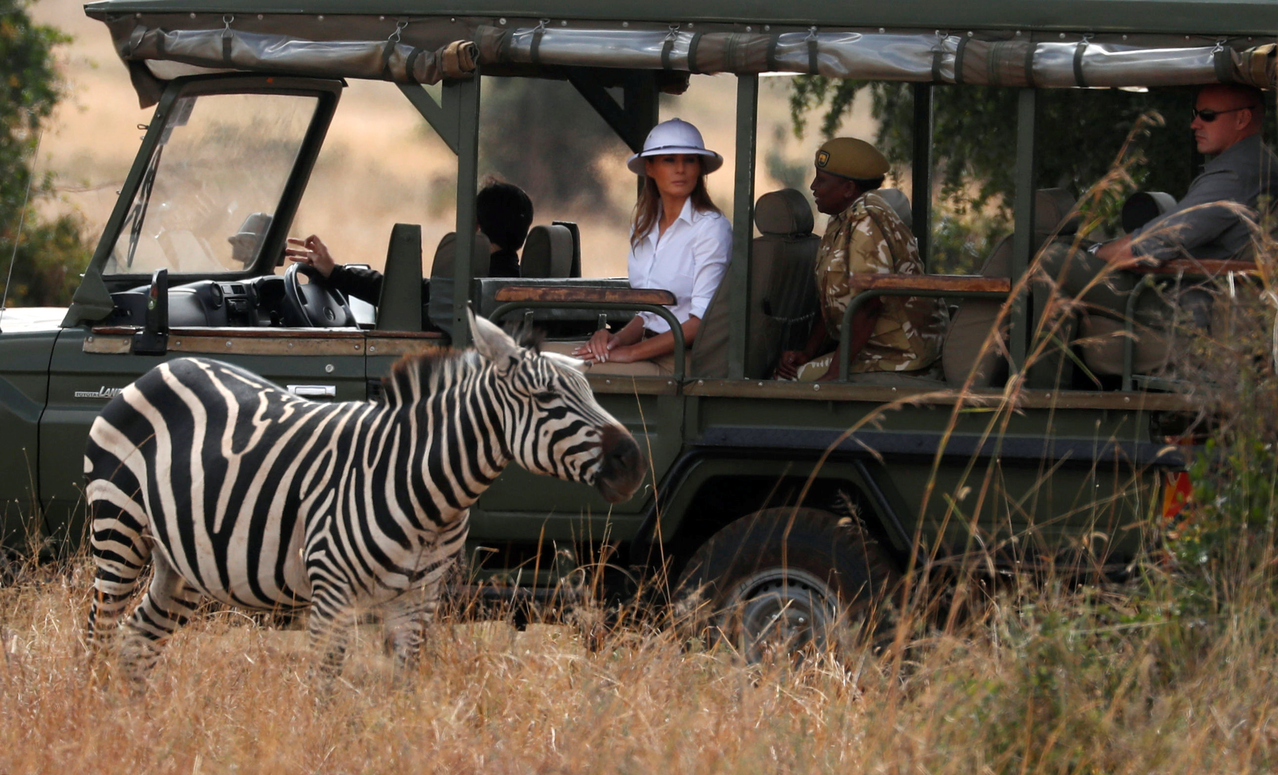 U.S. first lady Melania Trump looks at a zebra during her game drive at the Nairobi National Park in Nairobi
