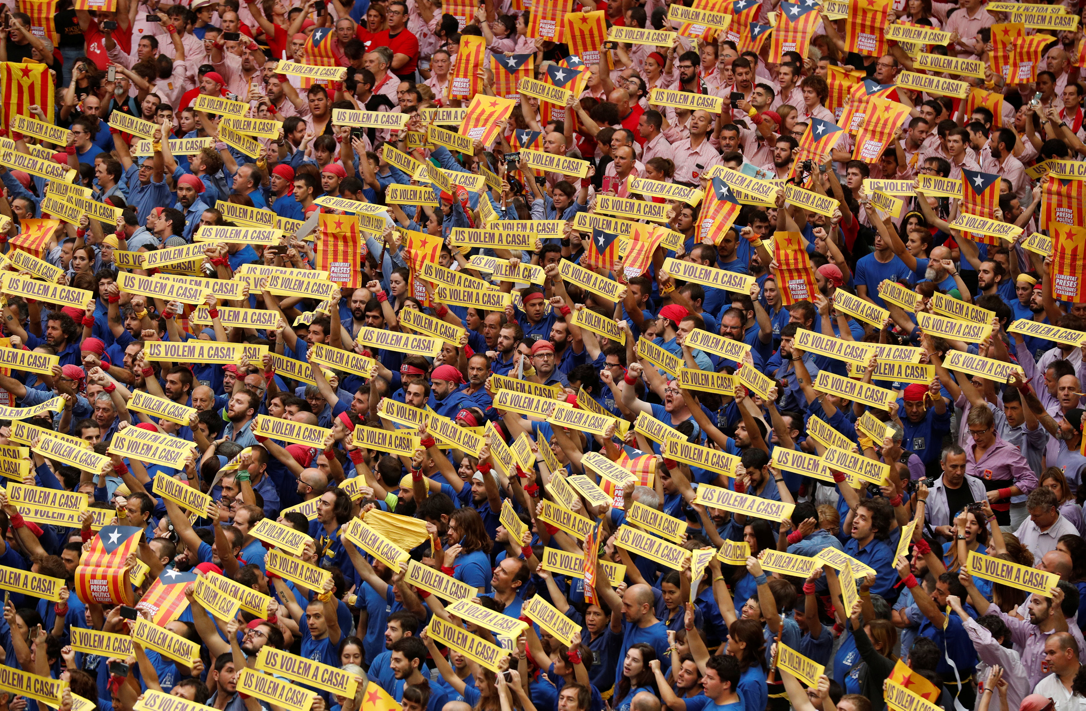 "People display baners as a support for political prisoners before a ""Castell"" competition in Tarragona"