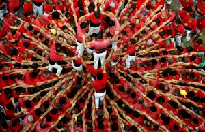 "Members of group ""Colla Joves Xiquets de Valls"" form a human tower called ""castell"" during a biannual human tower competition in Tarragona"