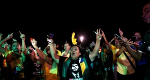 Supporters of Jair Bolsonaro, far-right lawmaker and presidential candidate of the Social Liberal Party (PSL), react, in Brasilia
