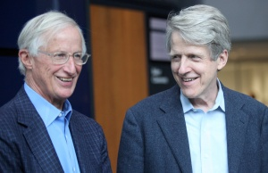 William D. Nordhaus, a professor at Yale University talks with Robert Shiller, an economist and 2013 Economics Nobel Laureate, after a news conference after winning the 2018 Nobel Economics Prize, at Yale University in New Haven