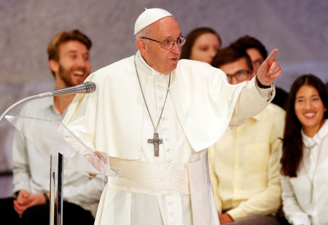 Pope Francis talks as he meets youth and the Synod Fathers at the Pope Paul VI hall in Vatican