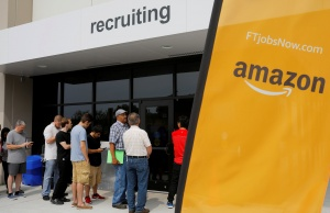 "Job seekers line up to apply during ""Amazon Jobs Day"" at the Amazon.com Fulfillment Center in Fall River"