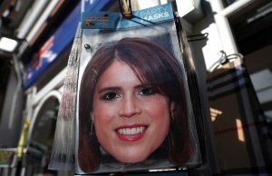 Face masks can be seen on sale at a gift shop ahead of the royal wedding between Princess Eugenie and Jack Brooksbank at Windsor Castle in Windsor