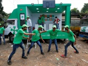 WhatsApp-Reliance Jio representatives perform in a street play during a drive by the two companies to educate users, on the outskirts of Kolkata