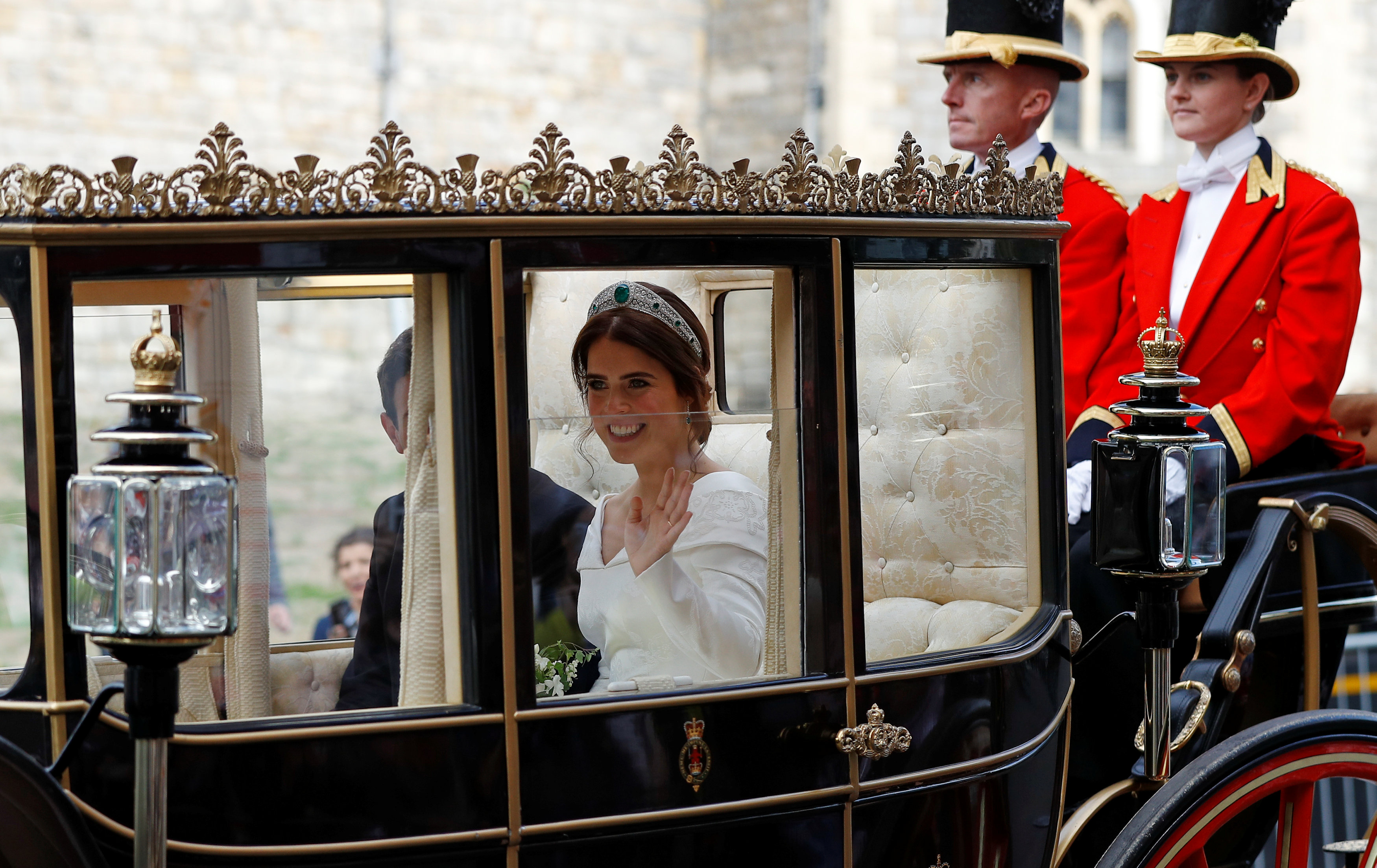 Britain's Princess Eugenie and Jack Brooksbank leave in a carriage after their wedding ceremony at Windsor Castle, Windsor