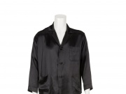 Hugh Hefner Julien's Auctions image of Playboy founder Hugh Hefner's trademark black silk pajamas from Hugh Hefner collection going up for sale