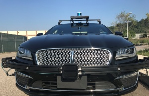 An Aurora self-driving Lincoln MKZ car is seen outside the company's office in the Lawrenceville neighborhood in Pittsburgh