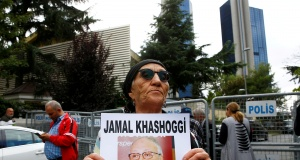 A human rights activist holds picture of Saudi journalist Jamal Khashoggi during a protest outside the Saudi Consulate in Istanbul