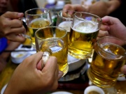 People drink beer in a restaurant in Hanoi