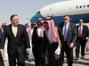 U.S. Secretary of State Mike Pompeo walks with Saudi Foreign Minister Adel al-Jubeir after arriving in Riyadh