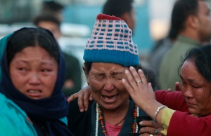 Family members of the Nepali mountaineering guides who were killed in anavalanche react in Kathmandu