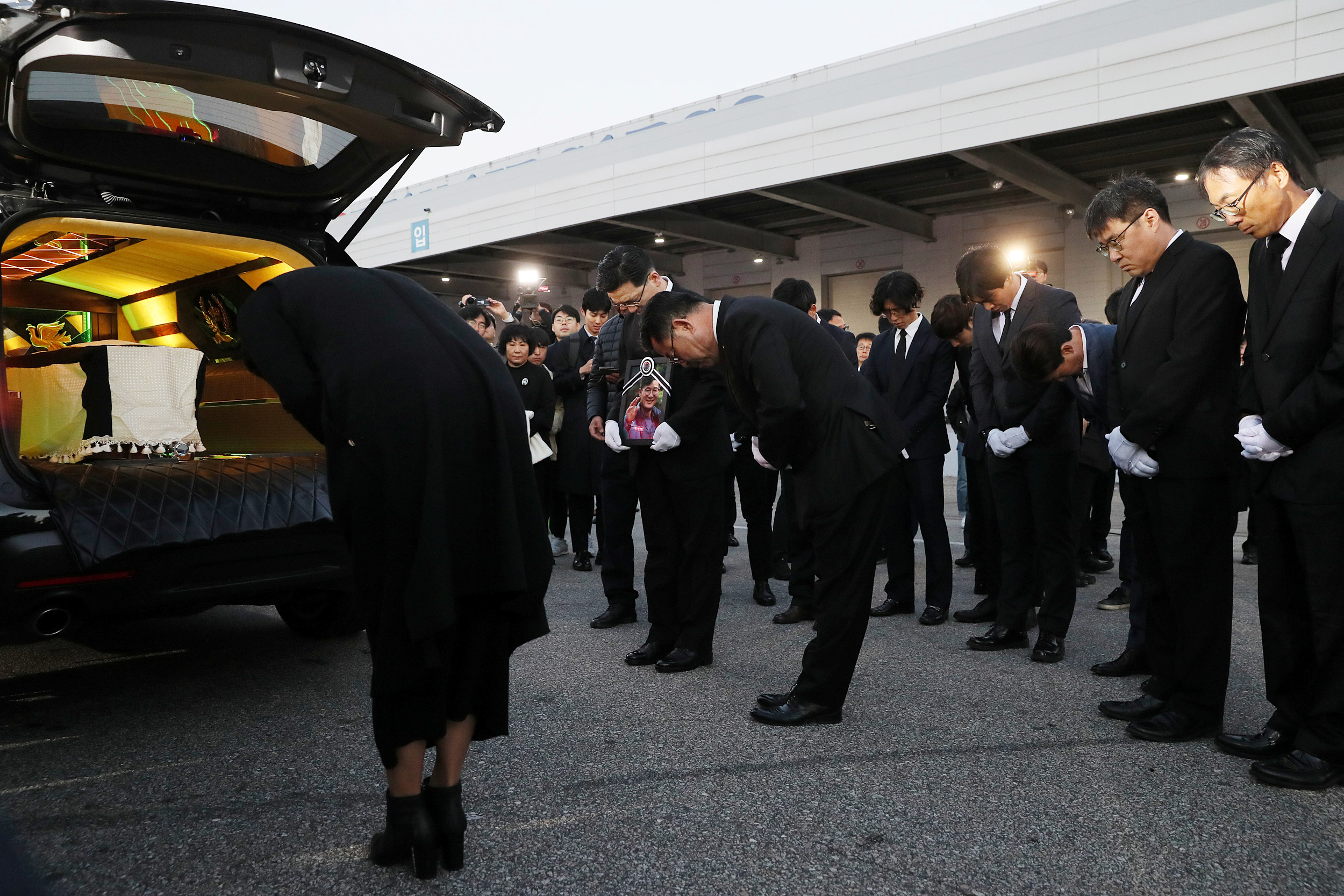 Family members and relatives bow to coffins carrying the five South Korean climbers who were killed in the Himalayas, at Incheon International Airport