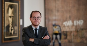 "Arnaud Oliveux, auctioneer, poses during a press preview ahead of the upcoming auction ""Search & Stop"" organized by Artcurial in Paris"