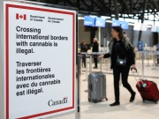 A sign warning travellers about crossing international borders with cannabis is seen at the Ottawa International Airport
