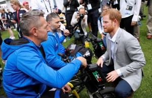 Britain's Prince Harry talks to Italian athletes during the Invictus Games at the Royal Botanic Garden in Sydney, Australia
