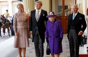 Britain's Queen Elizabeth and King Willem-Alexander of the Netherlands arrive at Buckingham Palace, in London